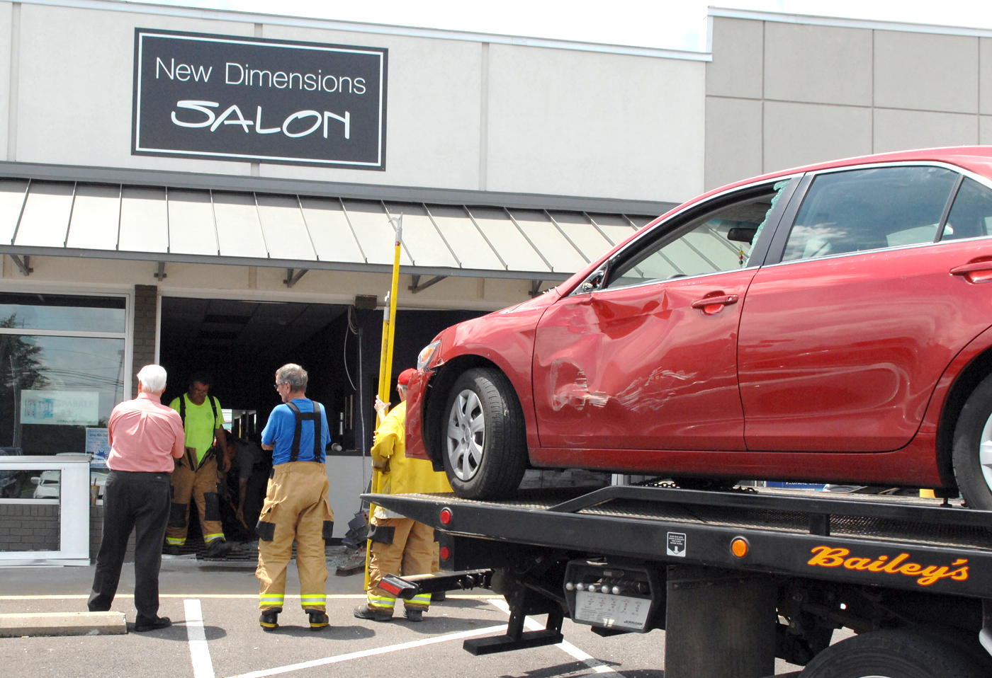 car hits pedestrian, crashes into salon | the lake news